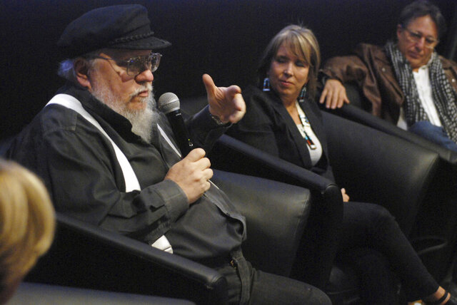 "FILE - In this Oct. 19, 2017, file photo, author and film producer, George R. R. Martin, left, speaks in Santa Fe, N.M. Martin, the famed author of the ""Game of Thrones"" fantasy series, has joined a group to buy the historic Santa Fe Southern Railroad, the Santa Fe New Mexican reported Sunday, May 24, 2020. (AP Photo/Morgan Lee, File)"