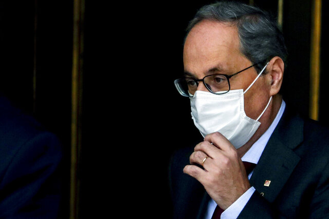 Catalan regional President Quim Torra gestures as he leaves the Spanish Supreme Court in Madrid, Spain, Thursday, Sept. 17, 2020. Spain's Supreme Court is hearing closing arguments over whether to uphold or overturn the barring from public office of Catalonia's separatist-minded regional leader. (AP Photo/Manu Fernandez)