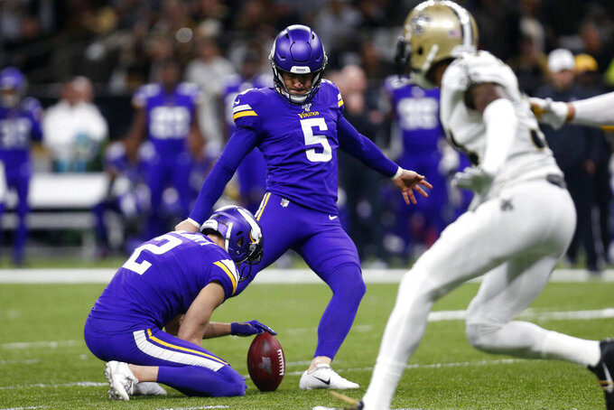 Minnesota Vikings kicker Dan Bailey (5) kicks a field goal as Britton Colquitt (2) holds in the first half of an NFL wild-card playoff football game against the New Orleans Saints, Sunday, Jan. 5, 2020, in New Orleans. (AP Photo/Butch Dill)
