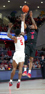 Southern Methodist's Jahmal McMurray (0) shoots as Houston's Corey Davis Jr. (5) defends during the first half of an NCAA college basketball game Thursday, March 7, 2019, in Houston. (AP Photo/David J. Phillip)