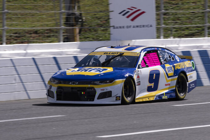 Chase Elliott (9) drives during a NASCAR Cup Series auto racing race at Charlotte Motor Speedway, Sunday, Oct. 10, 2021, in Concord, N.C. (AP Photo/Matt Kelley)