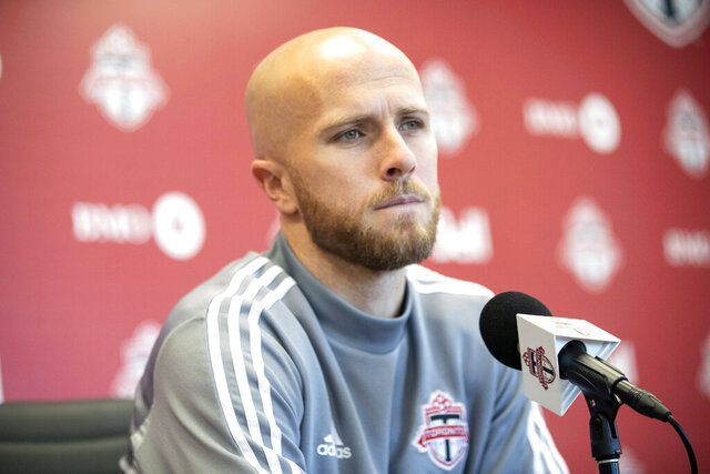 FILE - In this Nov. 13, 2019, file photo, Toronto FC MLS soccer player Michael Bradley speaks to the media during an end of season availability in Toronto, Wednesday,. Toronto FC training camp opened with a bang Monday with the news that captain Michael Bradley is scheduled to undergo ankle surgery and could be out for four months or more. (Chris Young/The Canadian Press via AP, File)