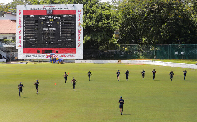 Members of Sri Lankan cricket team attend their first training session after more than two months of restrictions to prevent the spread of the new coronavirus in Colombo, Sri Lanka, Tuesday, June 2, 2020. (AP Photo/Eranga Jayawardena)