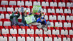 Cleveland State fans cheer in the stands during the first half of a first-round game against Houston in the NCAA men's college basketball tournament, Friday, March 19, 2021, at Assembly Hall in Bloomington, Ind. (AP Photo/Doug McSchooler)