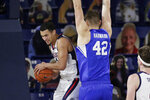 Gonzaga guard Jalen Suggs, left, grabs a rebound next to BYU center Richard Harward during the first half of an NCAA college basketball game in Spokane, Wash., Thursday, Jan. 7, 2021. (AP Photo/Young Kwak)