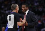 Detroit Pistons head coach Dwane Casey, right, talks with referee Ken Mauer during the second half of Game 4 of a first-round NBA basketball playoff series against the Milwaukee Bucks, Monday, April 22, 2019, in Detroit. (AP Photo/Carlos Osorio)