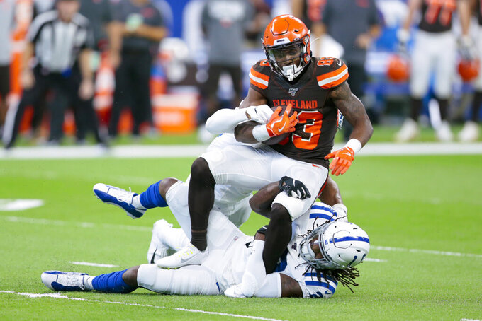 Cleveland Browns wide receiver D.J. Montgomery (83) is tackled by Indianapolis Colts middle linebacker Anthony Walker (50) and free safety Malik Hooker (29) during the first half of an NFL preseason football game in Indianapolis, Saturday, Aug. 17, 2019. (AP Photo/AJ Mast)