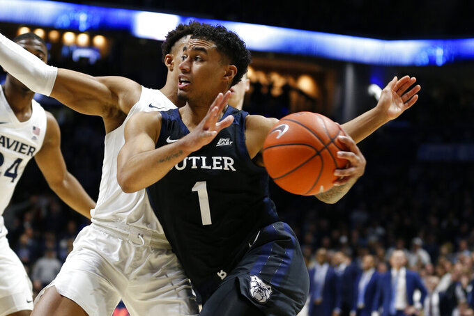 Butler forward Jordan Tucker (1) drives to the basket in front of Xavier guard Bryce Moore, rear, during the second half of an NCAA college basketball game Saturday, March 7, 2020, in Cincinnati. Butler won 72-71. (AP Photo/Gary Landers)