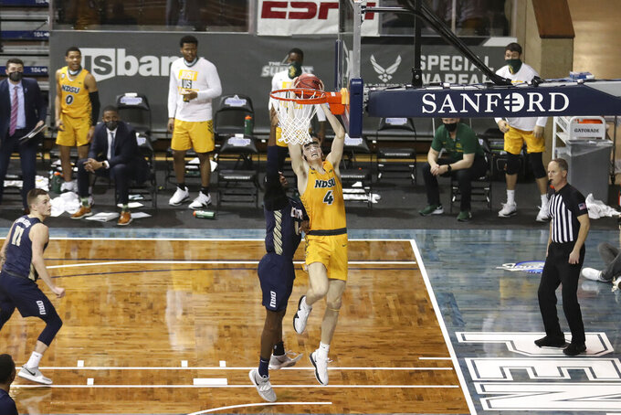 North Dakota State forward Grant Nelson (4) drives the baseline for a dunk against Oral Roberts during an NCAA college basketball game for the Summit League men's tournament championship Tuesday, March 9, 2021, in Sioux Falls, S.D. (AP Photo/Josh Jurgens)