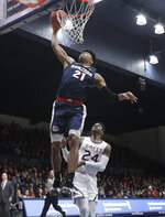 Gonzaga forward Rui Hachimura (21) dunks over Saint Mary's forward Malik Fitts (24) during the first half of an NCAA college basketball game in Moraga, Calif., Saturday, March 2, 2019. (AP Photo/Jeff Chiu)