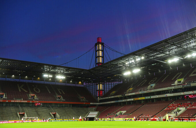 The stands are empty during the German Bundesliga soccer match between 1. FC Cologne and RB Leipzig, in Cologne, Germany, Monday, June 1, 2020. Because of the coronavirus outbreak all soccer matches of the German Bundesliga take place without spectators. (Ina Fassbender/Pool via AP)