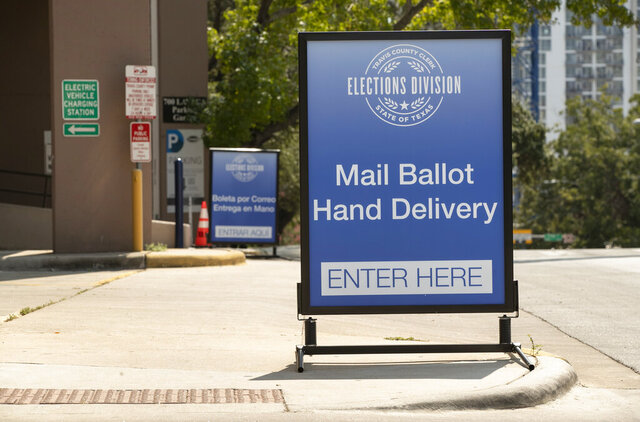 A sign indicates a drive-through ballot drop off location at the 700 Lavaca Parking Garage in Austin, Texas, on Thursday Oct. 1, 2020, shortly after an order was announced by Gov. Greg Abbott restricting such drop off locations. Civil rights and voter advocacy groups have filed a federal lawsuit seeking to block an order by Gov. Abbott that dramatically reduced the number of drop-off locations for mail ballots. The lawsuit filed late Thursday could be the first of many legal challenges against Abbott's order that assigns just one drop-off location in each of Texas' 254 counties and allows poll watchers to observe ballot deliveries.  (Jay Janner)/Austin American-Statesman via AP)