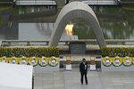Japanese Prime Minister Shinzo Abe walks off after delivering a speech during a ceremony to mark the 75th anniversary of the bombing at the Hiroshima Peace Memorial Park Thursday, Aug. 6, 2020, in Hiroshima, western Japan. (AP Photo/Eugene Hoshiko)