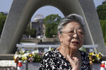 "Koko Kondo speaks during an interview with The Associated Press in front of the cenotaph for the atomic bombing victims near Hiroshima Peace Memorial Museum in Hiroshima, western Japan Wednesday, Aug. 5, 2020. Kondo was determined to find the person who dropped the atomic bomb on Hiroshima, western Japan, the person that caused the suffering and the terrible facial burns of the girls at her father's church - and then square off and punch them in the face. Ten-year-old Kondo appeared on an American TV show called ""This is Your Life"" that was featuring her father, Rev. Kiyoshi Tanimoto, one of six survivors profiled in John Hersey's book ""Hiroshima."" Kondo stared in hatred at another guest: Capt. Robert Lewis, co-pilot of B-29 bomber Enola Gay that dropped the bomb. (AP Photo/Eugene Hoshiko)"