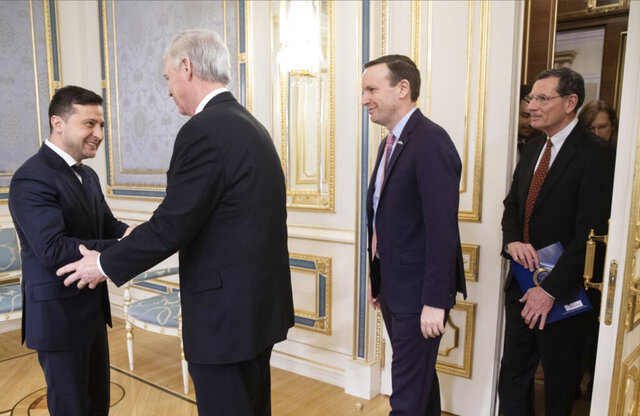 Ukrainian President Volodymyr Zelenskiy, left, greets U.S. Senators Ron Johnson Chris, second left, Chris Murphy and John Barrasso during their visit in Kyiv, Ukraine, Friday, Feb. 14, 2020. (Ukrainian Presidential Press Office via AP)