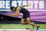 Ohio State defensive back Jeff Okudah runs the 40-yard dash at the NFL football scouting combine in Indianapolis, Sunday, March 1, 2020. (AP Photo/Charlie Neibergall)