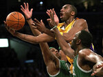 FILE - In this Friday, Feb. 23, 2006, file photo, Los Angeles Lakers' Kobe Bryant, TOP, goes up for a shot between the Boston Celtics' Paul Pierce, left, and Al Jefferson during the first half of an NBA basketball game in Los Angeles. Federal investigators said Wednesday, June 17, 2020, that the pilot of the helicopter that crashed in thick fog, killing Kobe Bryant and seven other passengers, reported he was climbing when he actually was descending. (AP Photo/Branimir Kvartuc, File)