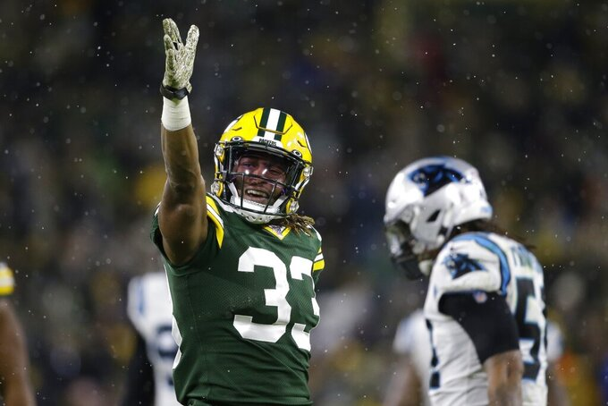 Green Bay Packers' Aaron Jones reacts after a first down run during the second half of an NFL football game against the Carolina Panthers Sunday, Nov. 10, 2019, in Green Bay, Wis. (AP Photo/Jeffrey Phelps)