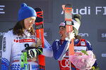 First placed Slovakia's Petra Vlhova, left and first placed Italy's Federica Brignone celebrate on the podium at the end of an alpine ski, World Cup women's giant slalom in Sestriere, Italy, Saturday, Jan. 18, 2020. Federica Brignone and Petra Vlhova have tied for a World Cup giant slalom victory while overall leader Mikaela Shiffrin finished third by the smallest of margins. (AP Photo/Marco Trovati)
