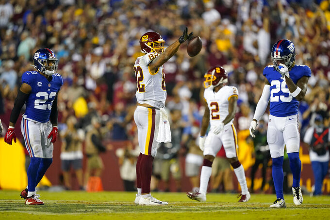 Washington Football Team tight end Logan Thomas (82) releases the ball after making a successful catch for the first down against the New York Giants during the first half of an NFL football game, Thursday, Sept. 16, 2021, in Landover, Md. (AP Photo/Al Drago)