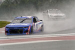 Kyle Larson (5) leads Anthony Alfredo (38) out of Turn 18 during practice for Sunday's NASCAR Cup Series auto race at the Circuit of the Americas in Austin, Texas, Saturday, May 22, 2021. (AP Photo/Chuck Burton)