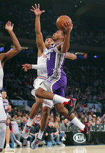 Sacramento Kings guard Buddy Hield (24) goes up for a shot against New York Knicks guard Allonzo Trier (14) during the first quarter of an NBA basketball game, Saturday, March 9, 2019, in New York. (AP Photo/Julie Jacobson)