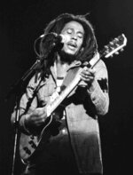 "FILE - In this July 4, 1980 file photo, Jamaican reggae singer Bob Marley performs at a reggae festival concert in Paris. The family of Bob Marley are covering his song ""One Love"" to raise money for coronavirus relief efforts. (AP Photo/File)"