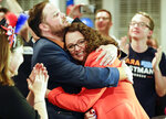 Democratic 2nd District House candidate Kara Eastman hugs her campaign manager Ben Onkka, in Omaha, Neb., Tuesday, May 15, 2018, as she holds a slim lead over Brad Ashford in the primary election. Omaha-area voters are set to pick a Democratic nominee Tuesday who will challenge U.S. Rep. Don Bacon, R-Neb., after the congressman claimed the seat from Democrats two years ago. (AP Photo/Nati Harnik)