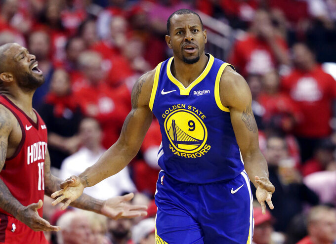 FILE - In this May 10, 2019, file photo, Golden State Warriors guard Andre Iguodala celebrates after a score against the Houston Rockets during the second half in Game 6 of a second-round NBA basketball playoff series, in Houston. Free agent forward Iguodala is returning to the Warriors, whom he helped win the 2015 championship on his way to becoming the NBA Finals MVP. (AP Photo/Eric Gay, File)