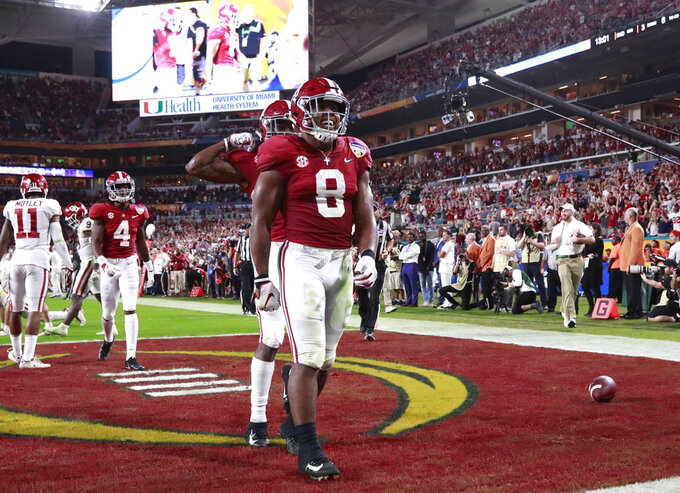 Alabama running back Josh Jacobs (8) celebrates his touchdown, during the first half of the Orange Bowl NCAA college football game against Oklahoma , Saturday, Dec. 29, 2018, in Miami Gardens, Fla. (AP Photo/Wilfredo Lee)