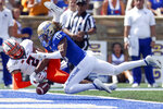 Oklahoma State wide receiver Tylan Wallace (2) attempts to catch a pass in the end zone while being defended by Tulsa safety Manny Bunch (10) during an NCAA college football game Saturday, Sept. 14, 2019, in Tulsa, Okla. Bunch was called for defensive pass interference on the play. (Ian Maule/Tulsa World via AP)
