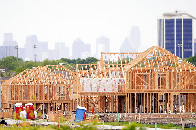 The frame of new home under construction sits in a neighborhood under development in north Dallas, Thursday, April 15, 2021. The first numbers from the 2020 census show southern and western states gaining congressional seats. The once-a-decade head count shows where the population grew during the past 10 years and where it shrank. (AP Photo/LM Otero)