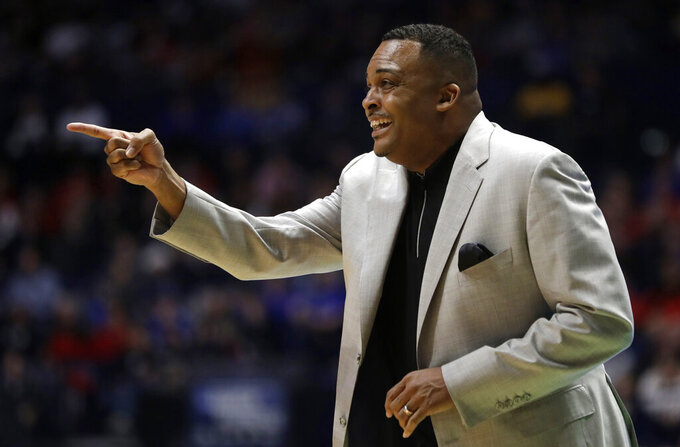 FILE- In this March 16, 2018, file photo Georgia State head coach Ron Hunter calls out form the bench during their first-round game against Cincinnati in the NCAA college basketball tournament in Nashville, Tenn. Hunter's eager for more NCAA Tournament glory. He has built a once-dismal Georgia State program into a mid-major with a knack for bracket-busting. Before the memorable upset of Baylor, Hunter's 2001 team was a No. 11 seed which upset No. 6 Wisconsin in the first round. (AP Photo/Mark Humphrey, File)