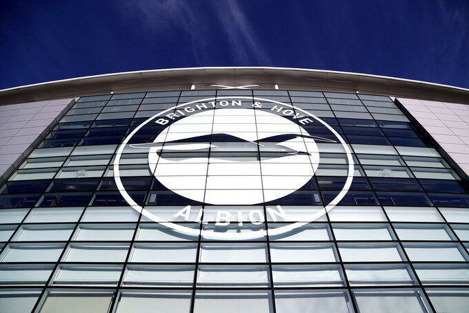 FILE - This Jan, 18, 2020 file photo shows a general view of the club crest on the side of the AMEX Stadium, home to Brighton & Hove Albion, Brighton, England. A Brighton player tested positive for the coronavirus as Premier League clubs prepare for talks on Monday, May 11 about how to resume the competition during the pandemic. The southern England club told The Associated Press there is no need for other members of the squad or coaches to self-isolate because players have only worked in isolation when at the training base. (Gareth Fuller/PA via AP, file)