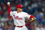 Philadelphia Phillies infielder Ronald Torreyes pitches during the eighth inning of the team's baseball game against the Atlanta Braves, Saturday, July 24, 2021, in Philadelphia. (AP Photo/Chris Szagola)