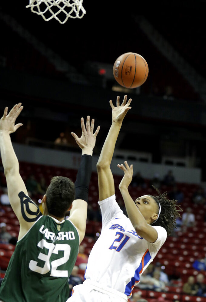 Colorado State's Nico Carvacho (32) covers a shot from Boise State's Derrick Alston (21) during the first half of an NCAA college basketball game in the Mountain West Conference tournament, Wednesday, March 13, 2019, in Las Vegas. (AP Photo/Isaac Brekken)