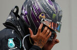 Mercedes driver Lewis Hamilton of Britain reacts after winning the Turkish Formula One Grand Prix at the Istanbul Park circuit racetrack in Istanbul, Sunday, Nov. 15, 2020. (Murad Sezer/Pool via AP)