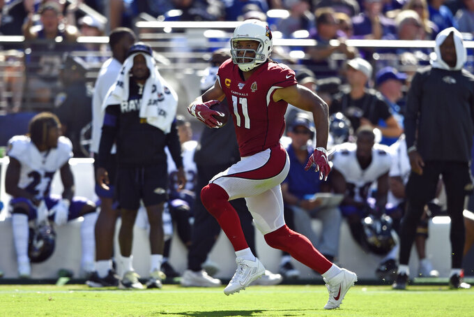 Arizona Cardinals wide receiver Larry Fitzgerald rushes the ball in the second half of an NFL football game against the Baltimore Ravens, Sunday, Sept. 15, 2019, in Baltimore. (AP Photo/Gail Burton)