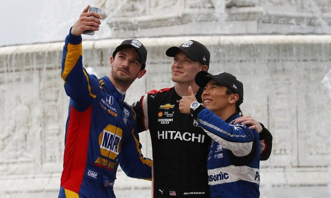 Alexander Rossi, left, takes a selfie with race winner Josef Newgarden, center, and third place finisher Takuma Sato, of Japan, after the first race of the IndyCar Detroit Grand Prix auto racing doubleheader, Saturday, June 1, 2019, in Detroit. (AP Photo/Carlos Osorio)