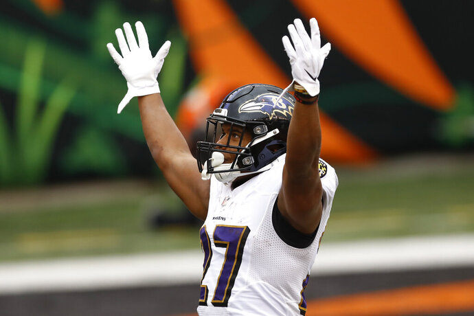 Baltimore Ravens running back J.K. Dobbins (27) celebrates after scoring a touchdown against the Cincinnati Bengals during the second half of an NFL football game, Sunday, Jan. 3, 2021, in Cincinnati. (AP Photo/Aaron Doster)