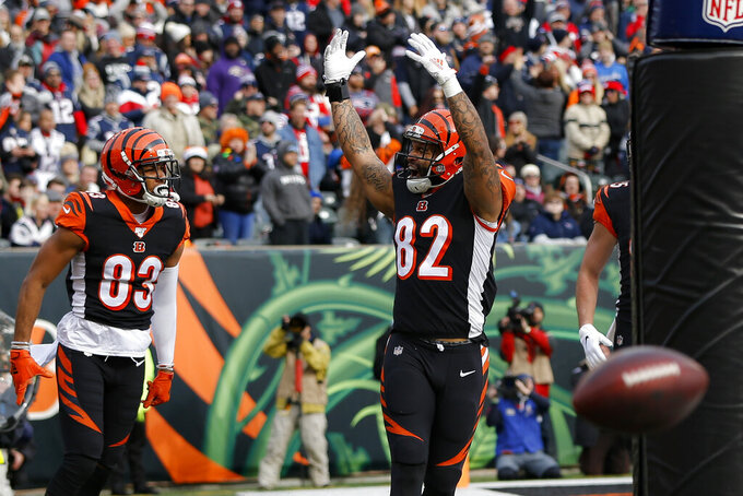 Cincinnati Bengals tight end Cethan Carter (82) celebrates his touchdown in the first half of an NFL football game against the New England Patriots, Sunday, Dec. 15, 2019, in Cincinnati. (AP Photo/Frank Victores)