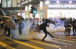 A protestor kicks away a police teargas shell as they clash outside a shopping mall in Hong Kong, Sunday, Nov. 10, 2019. Protesters smashed windows in a subway station and a shopping mall Sunday and police made arrests in areas across Hong Kong amid anger over a demonstrator's death and the arrest of pro-democracy lawmakers.Hong Kong is in the sixth month of protests that began in June over a proposed extradition law and have expanded to include demands for greater democracy and other grievances. (AP Photo/Kin Cheung)