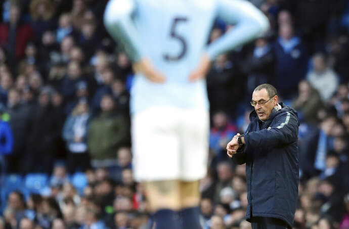 Chelsea manager Maurizio Sarri, right, reacts during the English Premier League soccer match between Manchester City and Chelsea at Etihad stadium in Manchester, England, Sunday, Feb. 10, 2019. (AP Photo/Jon Super)