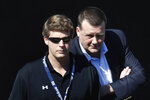 FILE - In this Feb. 19, 2008, file photo, New York Yankees senior vice president Hank Steinbrenner, right, talks to his brother Hal Steinbrenner while watching action in the bullpen during spring training baseball workouts in Tampa, Fla. Henry