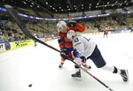 Norway's Anders Bastiansen, left, challenges for the puck with Quinn Hughes, right, of the United States during the Ice Hockey World Championships group B match between Norway and the United States at the Jyske Bank Boxen arena in Herning, Denmark, Sunday, May 13, 2018. (AP Photo/Petr David Josek)