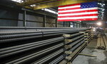 FILE - In this May 9, 2019, photo, steel rods produced at the Gerdau Ameristeel mill in St. Paul, Minn. await shipment. Japan hopes it can reach an agreement that would exempt it from President Donald Trump's steel and aluminum tariffs and the from threat of auto tariffs. In exchange, Tokyo would grant America's farmers greater access to the Japanese market. (AP Photo/Jim Mone, File)