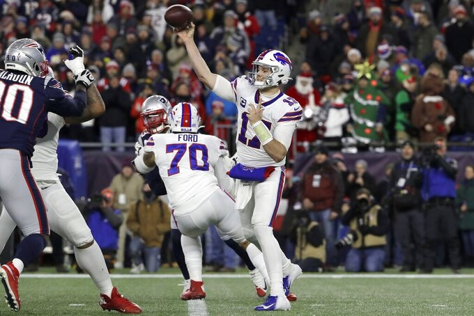 Buffalo Bills quarterback Josh Allen passes against the New England Patriots in the first half of an NFL football game, Saturday, Dec. 21, 2019, in Foxborough, Mass. (AP Photo/Steven Senne)