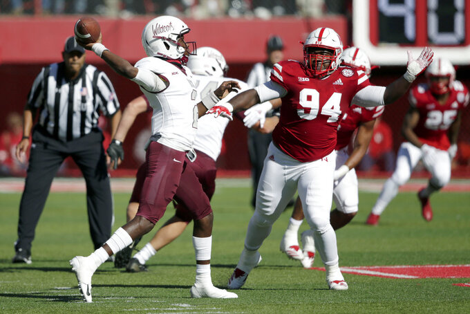 Bethune-Cookman quarterback David Israel, left, throws under pressure from Nebraska defensive lineman Khalil Davis (94) during the first half of an NCAA college football game in Lincoln, Neb., Saturday, Oct. 27, 2018. (AP Photo/Nati Harnik)