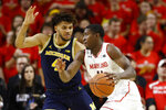 Maryland guard Darryl Morsell, right, drives against Michigan forward Isaiah Livers in the first half of an NCAA college basketball game, Sunday, March 3, 2019, in College Park, Md. (AP Photo/Patrick Semansky)