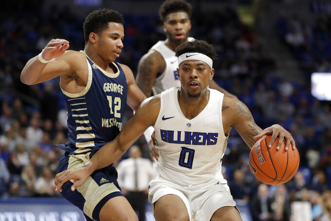 Saint Louis' Jordan Goodwin (0) heads to the basket past George Washington's Jameer Nelson Jr. (12) during the second half of an NCAA college basketball game Wednesday, Jan. 8, 2020, in St. Louis. (AP Photo/Jeff Roberson)
